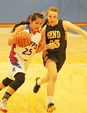 JEFF WILSON/THE PIONEER - The Buffs' Kiersten Anderson tries to drive around Bend's Allison Parker during Tuesday night's nonconference game at the Buffalo Dome.
