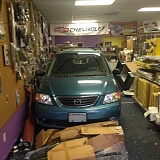 SUBMITTED PHOTO - A car traveling backward slammed into an Aloha auto parts store at about noon Thursday, injuring a store employee. The elderly van driver who suffered a medical event that triggered the crash also was treated at a hospital.