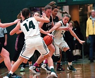 DAN BROOD - From left, Tigard junior Abby Portwood, Tualatin senior Emily Leonard and Tigard sophomore Gabby McGaughey battle for the ball during Tuesday's game. The Tigers scored a 41-23 victory.