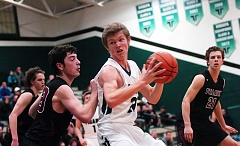 DAN BROOD - Tigard sophomore post Austin Dufort (with ball) looks to go to the basket against Tualatin senior Luke Osborn.