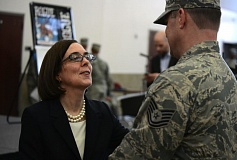 PHOTO BY TECH. SGT. JASON VAN MOURIK - Oregon Gov. Kate Brown greets 116th Air Control Squadron members based at Camp Rilea, in Warrenton, Ore., who operated and maintained surveillance, communications and air space management systems around the Arabian Gulf.