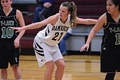 THE OUTLOOK: DAVID BALL - Damascus Christian's Ashlynn Jones sets up between a pair of Lakers during an Eagles' free-throw attempt.