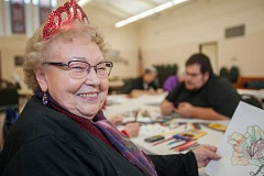 OUTLOOK PHOTO: JOSH KULLA - Edith Flesher,  beams as she enjoys her 90th birthday party at Redeemer Lutheran Church.