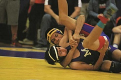 PHIL HAWKINS - Gervais' Ricardo Flores-Galvez wraps up Myrtle Point's Tyler Huerta for a quick pin in the quarterfinals of the Gervais Cougar Classics' 106-pound bracket. Flores-Galvez went on to take the bracket championship with three pins, each in under a minute of mat time.