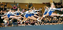 SUBMITTED PHOTO - Floating on air - The Newberg High School cheerleading team's blue squad performs an exhibition routine Saturday at the Newberg Classic. It was the first time the Tigers have ever hosted a tournament, but head coach Lisa Berg hopes to turn the event into a tradition. Newberg will return to competition Saturday at Clackamas. 'We're getting our feet wet and getting ready, hopefully, to peak at state,' Berg said.