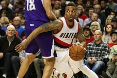 TRIBUNE PHOTO: DAVID BLAIR - Damian Lillard of the Trail Blazers drives around Sacramento's Omri Casspi during Portland's rout of the Kings on Tuesday night at Moda Center.