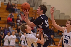 SPOKESMAN FILE PHOTO: COREY BUCHANAN - Wilsonville wing Zach Reichle crashes into a Liberty player during a game Friday, Jan. 15.