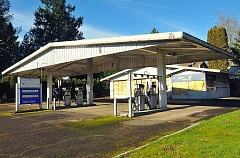 TIDINGS PHOTO: VERN UYETAKE - More than 20 years after soil contamination was first discovered at the site of this shuttered gas station and auto shop, its last tanks are going to be decommisisoned and testing completed.