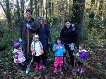 SUBMITTED PHOTO - Volunteers of all ages help the Oswego Lake Watershed Council remove invasive species in 2015 at a site on Hallinan Creek.