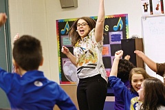 THE TIMES: JAIME VALDEZ - Kim Putnam, a music teacher at Hazeldale Elementary School, dances with third-graders to the song Sasha, a Russian dance mix, during class. Putnam was recently received the Oregon Excellence in Elementary Music Education Award.