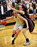 PAMPLIN MEDIA GROUP: VERN UYETAKE - Tualatin senior Hannah Self (right) plays tight defense against West Linn's Kennedy Fulcher.