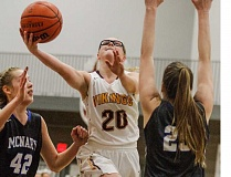 FOREST GROVE NEWS-TIMES PHOTOS: CHASE ALLGOOD - Forest Grove's Jodi Blomdahl splits the McNary defense to take a shot.