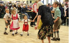INDEPENDENT FILE PHOTO - Party-goers of all ages have a good time at Wurstfest, which will be held Feb. 5-6 in the Mount Angel Festhalle.