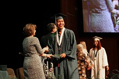 INDEPENDENT FILE PHOTO - Kris Huapeo receives his diploma at North Marion High School's 2015 graduation in June.