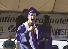 INDEPENDENT FILE PHOTO - Woodburn Academy of Art, Science and Technology valedictorian Vasilisk Kornilkin shows some enthusiasm at last year's Woodburn High School graduation. The graduation rates from that school year were recently released from the Oregon Department of Education.