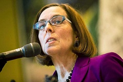 PAMPLIN MEDIA GROUP - Gov. Kate Brown is not trying to negotiate an alternative to a union-backed corporate tax ballot measure, despite meeting with interests on various sides of the divisive proposal.