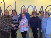 ESTACADA NEWS PHOTO: EMILY LINDSTRAND - Gil Zimbelman of Peace Luthern Church presents a $1,000 check to Estacada Community Center to help with its programs, including Meals on Wheels.