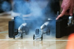 SANDY POST PHOTO: JOSH KULLA - A pair of CO2 powered dragsters take off across the Sandy High School gym floor during a recent competition hosted by the school's advanced manufacturing class.