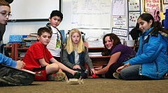 TIMES PHOTO: MILES VANCE - From left, Tualatin Elementary School fifth-graders Mason Johnson, Owen Heidt, Carlos Torres-Hernandez, Grace Richmond, Shelby Underwood and Jacquelin Salcedo-Miranda watch their balloon-powered car roll forward during a workshop on energy and friction.