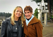 REVIEW, TIDINGS PHOTO: VERN UYETAKE - Kathleen Wiens, left, and Olive Gallagher stand close to one of the superb sculptures that made them fall in love with Lake Oswego.