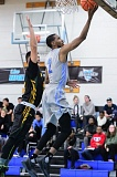 TRIBUNE PHOTO: CHRISTOPHER OERTELL - Taylor Young goes to the basket for Warner Pacific College, which has moved into third place in the Cascade Collegiate Conference.