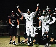 PAMPLIN MEDIA GROUP: DAN BROOD - Steffen Jacobsen (19), celebrating a Wilson Trojans score in the 2015 playoffs versus Tualatin, is one of several local players to sign with Portland State football.