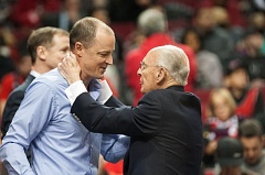 TRIBUNE PHOTO: JOSH KULLA - Portland Timbers owner Merritt Paulson (right) is greeted by Trail Blazers broadcasting legend Bill Schonley before Thursday night's game between Portland and Toronto.