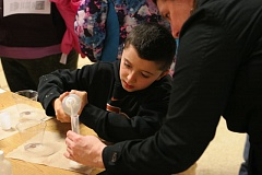 TIMES PHOTO: MARK MILLER - Aidan Valdez, a fourth-grader at Bridgeport Elementary School, adds liquid to a graduated cylinder while building a pressure rocket.