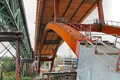 PAMPLIN MEDIA GROUP: DAVID F. ASHTON - This is a Sellwood Bee-exclusive photo juxtaposing the old and new Sellwood Bridges, taken from between the angel wings of Bent 5 in the middle of the Willamette River during construction.