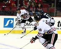 COURTESY: BRYAN HEIM/PORTLAND WINTERHAWKS - Keegan Iverson of the Portland Winterhawks looks to pass across the ice during Friday night's win at home over Seattle.