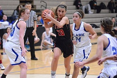 THE OUTLOOK: DAVID BALL - Mt. Hood CC point guard Jesse Morris slices through a crowd of Penguins on her way to two of her game-high 24 points Wednesday.