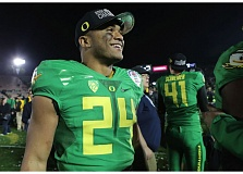 TRIBUNE FILE PHOTO: JAIME VALDEZ - Thomas Tyner celebrates with the Oregon Ducks after their College Football Playoff victory over Florida State at the Rose Bowl in January 2015.