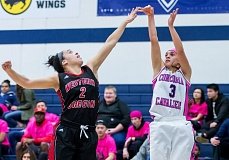 COURTESY: CHRISTOPHER OERTELL - Concordia guard Keesha Sarman (right) shoots over Western Oregon's Jazmin Bembry during a women's basketball game Tuesday night at Concordia.