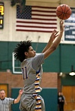 TRIBUNE PHOTO: JONATHAN HOUSE - Geno West of Jefferson High gets off a jump shot at Wilson.