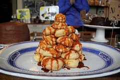 CONNECTION PHOTO: KELSEY O'HALLORAN - Maplewood Coffee & Tea owner Jo Whitsell created a croquembouche for the shop's first Cake Party on Jan. 31. The dessert features a pyramid of cream puffs drizzled in caramelized sugar.