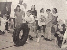 ARCHIVE PHOTO - In 2006, Eagle Creek School's annual sports challenge drew quite a crowd. Here, students roll tires in a relay race.