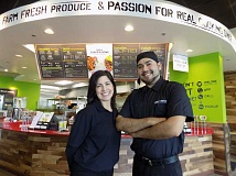 GAZETTE PHOTO: RAY PITZ - Rebecca Bristol, co-owner of the Sherwood Baja Fresh, and Jose Rivera, general manager, stand in front of the service counter at Baja Freshs new Sherwood location.