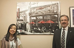 COURTESY PHOTO - Artist and competition winner Thi Doan and Hillsboro Mayor Jerry Willey pose in front of Unrushed, At the Venetian, an urbanscape painting by Doan.