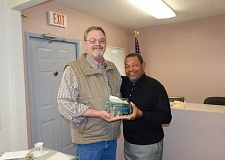 BARBARA SHERMAN - Mayor Ken Gibson (right) thanked outgoing City Manager Dave Wells for his service to the city at Wells' farewell coffee and presented him with a crystal plaque.