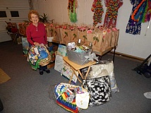 BARBARA SHERMAN - Joyce Saari's garage in KIng City became Sigma Phi Gamma convention central in February when all the goodie bags and raffle baskets were assembled before the annual event that was held the first weekend in March.