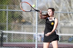 NEWS-TIMES PHOTO: AMANDA MILES - Sophomore Sarah Dixon hits a forehand during Forest Groves nonleague tennis dual against Tigard last Friday. Dixon has improved a lot since last season and has started this spring playing No. 2 singles for the Vikings.