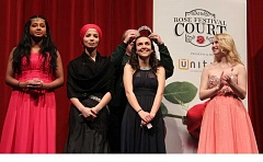CONNECTION PHOTO: KELSEY O'HALLORAN - Wilson's Rose Festival Court candidates (from left) Ishara Handagala, Atiya Rauf, Estee Emlen and Stacy Andrews watch as vice principal Maude Lamont crowns the 2016 princess.