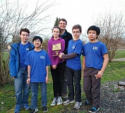 SUBMITTED PHOTO - Robert Gray Middle School chess players Sinan Grehan (from left), Christopher Ng, Kira Dobbins, parent advisor Jeff Dobbins, Michael Schuff and Ryuu Joy led the team to its state championship win in February.