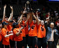 TRIBUNE PHOTO: JIM COWSERT - Oregon State players and coach Scott Rueck (right) celebrate with the regional trophy at Dallas on Monday night, after downing Baylor 60-57.