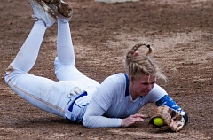 OUTLOOK PHOTO: JOSH KULLA - Barlow shortstop Meagan Bratcher makes a diving catch Monday in the Bruins' 5-3 loss to visiting Rex Putnam High School.