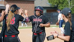 Nalani Antonio is congratulated by teammate Kylee Yamamoto (28) during Sunday's  NWC softball game against George Fox. The Boxers split a four-game series with the Bruins over the weekend.