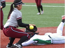 SANDY POST: PARKER LEE - Sandys Leslie Main gets in front of a ball and attempts to tag a diving Pendleton runner.