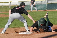 SANDY POST: PARKER LEE - Sandys Hunter York puts the tag on Reynolds base-runner Ethan Hopper during an 11-6 road loss Friday.