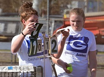THE OUTLOOK: DAVID BALL - Greshams Bailey Supan flips the scorecards during a second-set switchover alongside teammate Hannah Hohbach during the pairs 6-0, 6-1 win in No. 1 doubles.