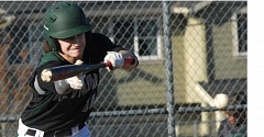 THE OUTLOOK: PARKER LEE - Reynolds Caleb Nutting sends a bunt in play during Fridays 11-6 home win over Sandy.